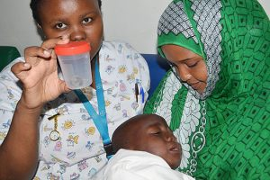Kenyan doctors remove coin stuck in boy's throat for two weeks (Photos)