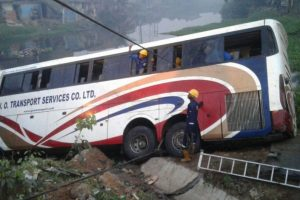 Two die, many injured as bus plunges into river